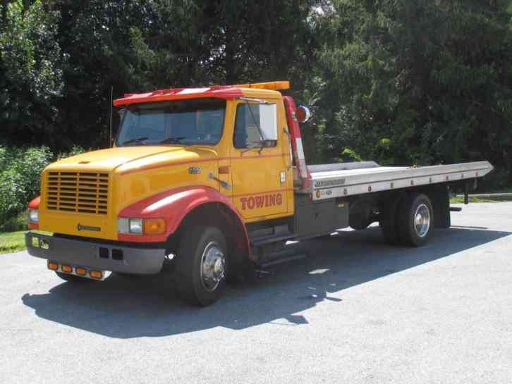 International 4700 rollback tow truck 1997 flatbeds for Used tow motors for sale