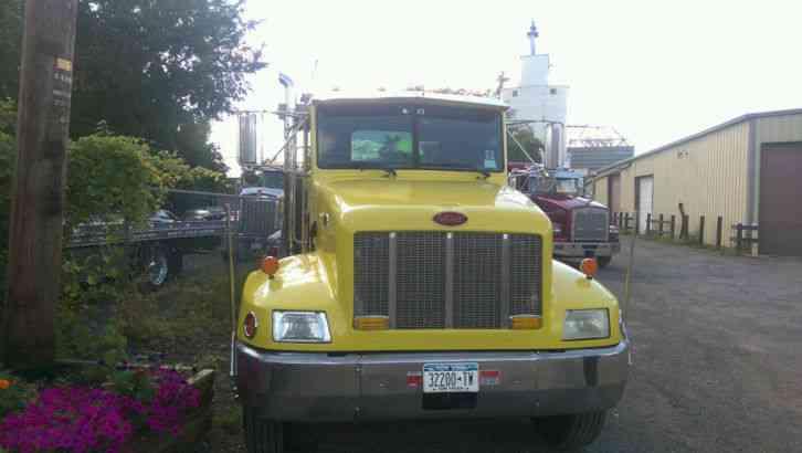 International 4700 2001 flatbeds rollbacks for Washington state motor vehicle emission inspection station