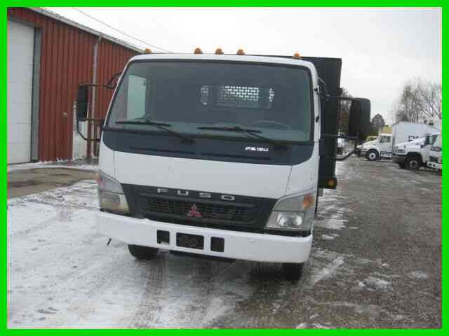 MITSUBISHI FE180 4 CYLINDER TURBO DIESEL 6 SPEED MANUAL TRANS WITH 16; FLATBED STAKE (2005)