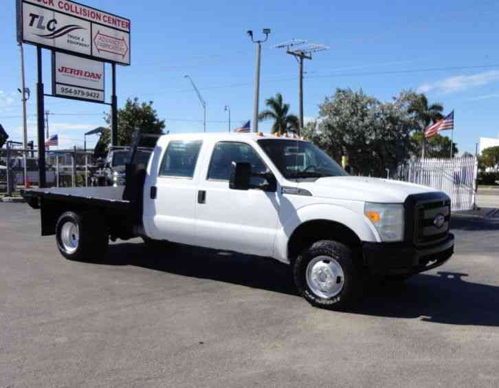 Ford F350 XL. . 4X4 CREW CAB 8FT STEEL FLATBED. . (2011)
