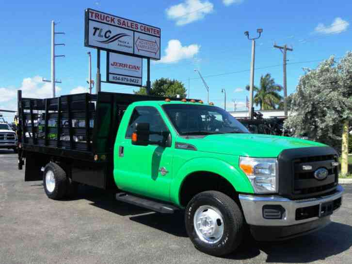 Ford F350 4X4. 12FT FLATBED STAKE BED WITH LIFTGATE. . STAKE TR (2013)